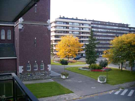 This the view you have when I told my parents a tornado was coming. The apartment block behind the yellow tree, there was the tornado coming from and torn of that roof and it was flying towards us. This is in Hasselt where I used to live.